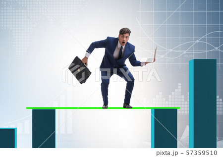Young businessman in business concept with bar charts 57359510