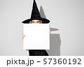 Young woman in hat as a witch on white background 57360192