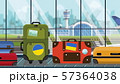 Suitcases with Ukrainian flag stickers on baggage carousel in airport, close-up. Tourism in Ukraine 57364038