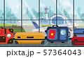 Suitcases with Vietnamese flag stickers on baggage carousel in airport, close-up. Tourism in Vietnam 57364043