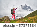 Portrait of hiker with a backpack at the beautiful mountains background. 57375384