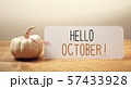 Hello October message with a small pumpkin 57433928