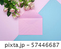 Mockup empty pink envelope and buds of pink roses, festive background, copy space 57446687