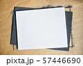 White sheet of paper on the background of kraft and black painted sheet with place for your text 57446690