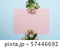 empty pink paper sheet and buds of pink roses, festive background, copy space 57446692