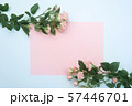 empty pink paper sheet and buds of pink roses, festive background, copy space 57446701