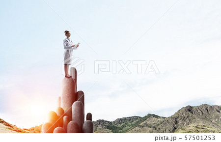 Medicine specialist or practitioner outdoors standing on top 57501253