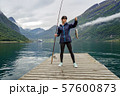 Woman fishing on Fishing rod spinning in Norway. 57600873