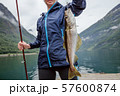 Woman fishing on Fishing rod spinning in Norway. 57600874