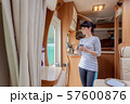 Woman in the interior of a camper RV motorhome 57600876