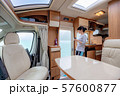 Woman in the interior of a camper RV motorhome 57600877