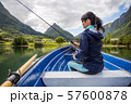 Woman fishing on Fishing rod spinning in Norway. 57600878