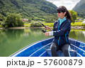 Woman fishing on Fishing rod spinning in Norway. 57600879