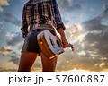 Woman at sunset holding a ukulele 57600887