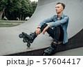 Roller skating, male skater poses on the ramp 57604417