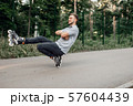 Roller skating, male teenager rolling in park 57604439