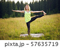 Woman doing yoga outdoors in summer 57635719