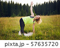 Woman doing yoga outdoors in summer 57635720