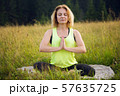 Woman doing yoga outdoors in summer 57635725