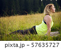 Woman doing yoga outdoors in summer 57635727