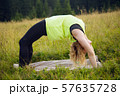 Woman doing yoga outdoors in summer 57635728
