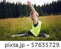 Woman doing yoga outdoors in summer 57635729