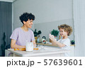 Happy child having fun with flour clapping hands cooking pastry with mom at home 57639601