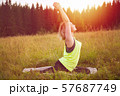 Woman doing yoga outdoors in summer 57687749