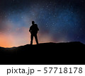 traveler standing on edge over night sky 57718178