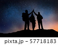 travelers making high five over starry night sky 57718183