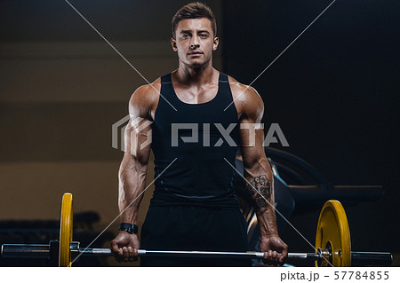 Handsome strong athletic men pumping up biceps 57784855