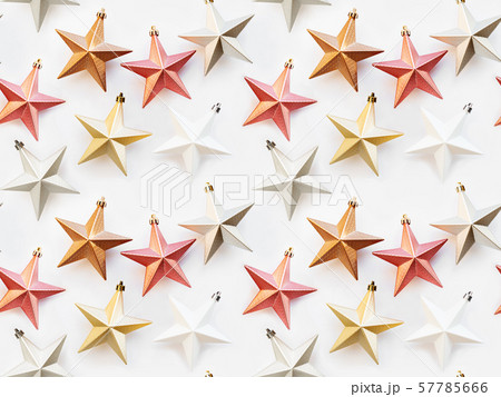 Seamless pattern. New Year background with decorative stars. Colorful decorations for Christmas tree. 57785666