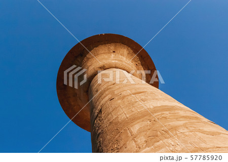 Columns in Karnak Temple Complex, famous architectural landmark in Luxor, Egypt. Pillars of the Great Hypostyle Hall from the Precinct of Amun-Re. 57785920