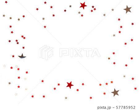 Frame made of scattering stars confetti on white background. Holiday backdrop. 57785952