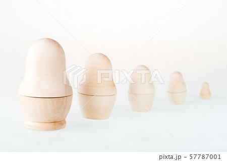 Clear wooden nesting dolls. Russian traditional toy, named matryoshka, on white background. Copy space. 57787001
