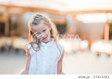Adorable happy little girl outdoors in italian city. 57813263