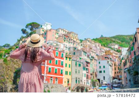 Young woman with great view at old village Riomaggiore, Cinque Terre, Liguria 57816472