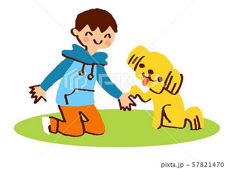 お手をする犬と男の子 57821470