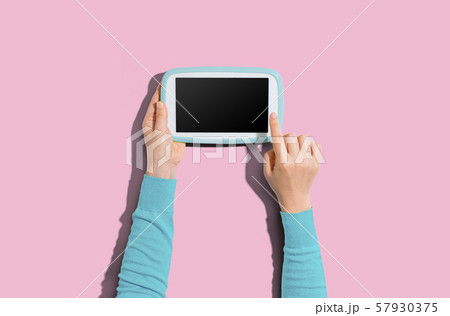 Person using a tablet computer 57930375
