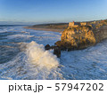 Lighthouse and big waves at in Nazare 57947202