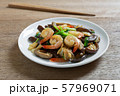stir fried shiitake mushroom and shrimp with soy sauce in a ceramic dish. 57969071
