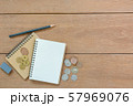 top view of japanese coins notebook pencil and eraser on wooden table with copy space.  57969076