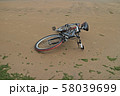 bike lies on the sand an empty beach 58039699