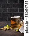 Mugs of beer, hops and malt 58064785