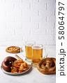 Beer, pretzels, sausages and stewed sauerkraut 58064797