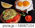 Avocado egg rye toast. Healthy vegetarian sandwich 58067154