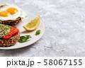 Avocado meal. Healthy egg rye bread toast. Brunch 58067155