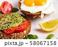 Avocado brunch. Egg toast on bread. Vegan Sandwich 58067158