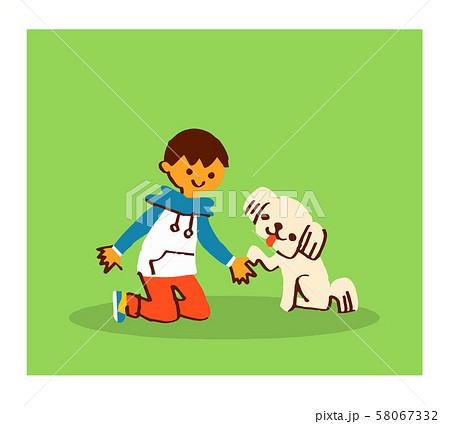 お手をする犬と男の子 58067332