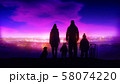 Family with two children and a dog on the evening winter walk. 58074220